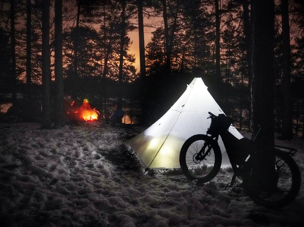 Camp around a fire in the Swedish forests.