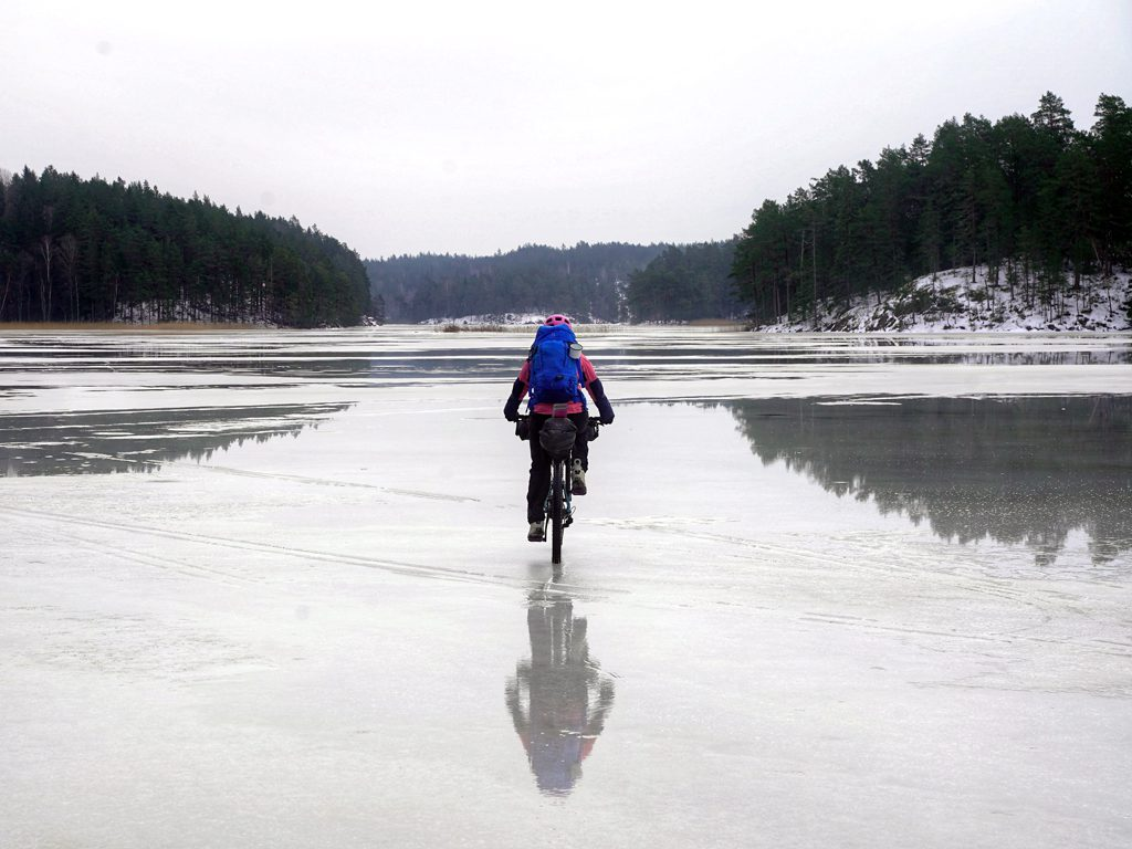 Riding across a frozen lake in Sweden