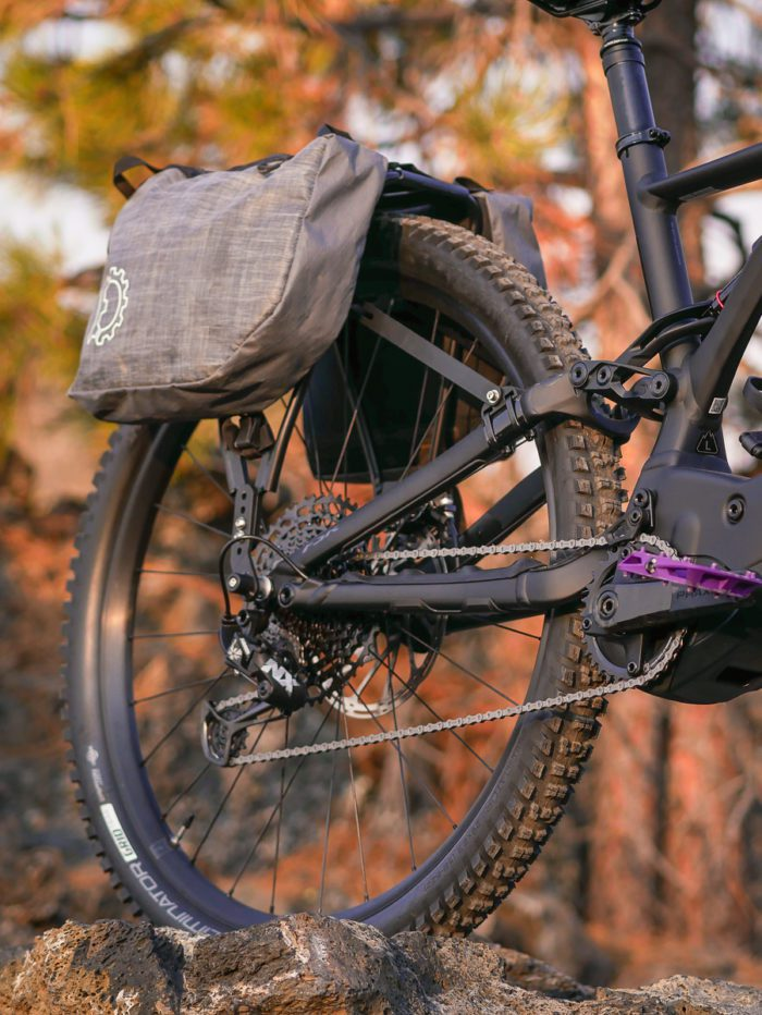 Pannier rack on the back of an emtb with revelate designs panniers