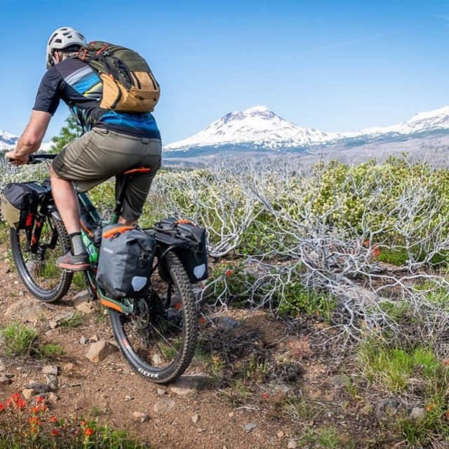 Riding on rugged and chunky trails takes a stable rack. Our axle mounted racks can carry more than eyelet mounts and provide an exceptionally stable foundation for our racks. Stability means you can feel the trail instead of your gear swinging side to side.  . .  #bike #bicycle #fromwhereiride #bikelife #travelbybike #rideabike #pedalforever #cyclinglife #bicyclewayoflife #lifeontwowheels #lifebehindbars #explore #bikepacking #biketouring #bicyclecargoracks #adventure #bicycleadventures #getoutandride #madeinusa