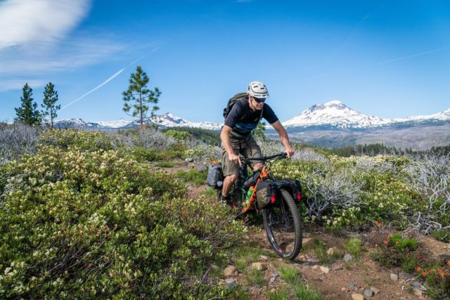 The snow is melting and the wild flowers are blooming! Our thru axle mountable racks make it easy to take our mountain bikes further into solitude while carrying the load lower and more securely than oversized seat bags. #ridefurther #oldmanmountain #fitanybike #bikerack #bikepacking #bikepackinggear