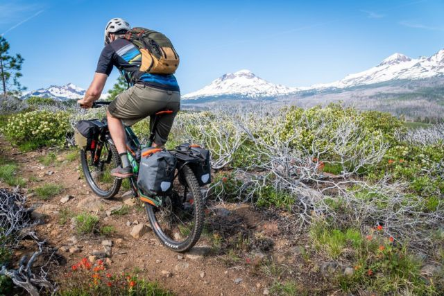 We love to ride so we can pause and take in views like this; sights so wonderful it's hard to stay on the trail. #bikepacking #oldmanmountain #bikerack #cycling #oregon #oregontimbertrail